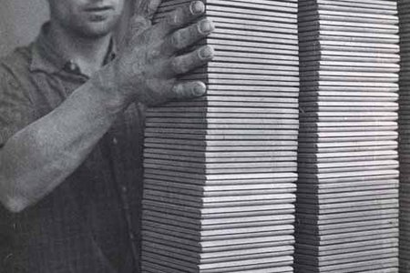The unfired tiles, stacked by skilled hands.